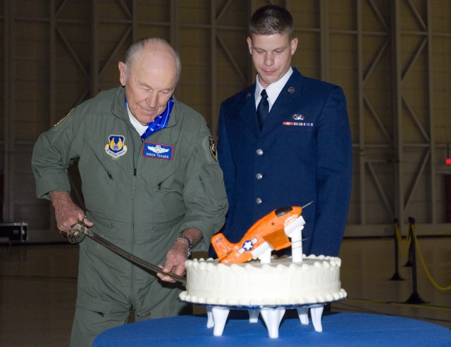 Chuck Yeager Cutting the Cake