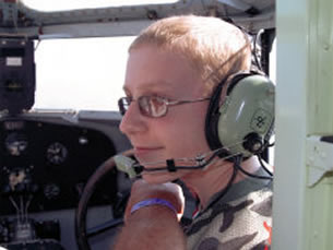Make-A-Wish Foundation Kid flying in the right seat with Chuck Yeager.