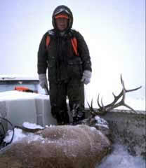 Chuck Yeager Standing Over Elk