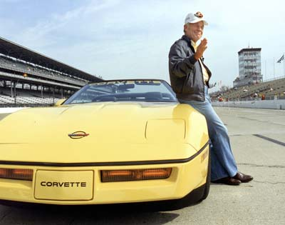 Chuck Yeager with a Yellow Corvette