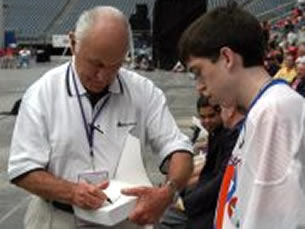 Chuck Yeager signing an autograph